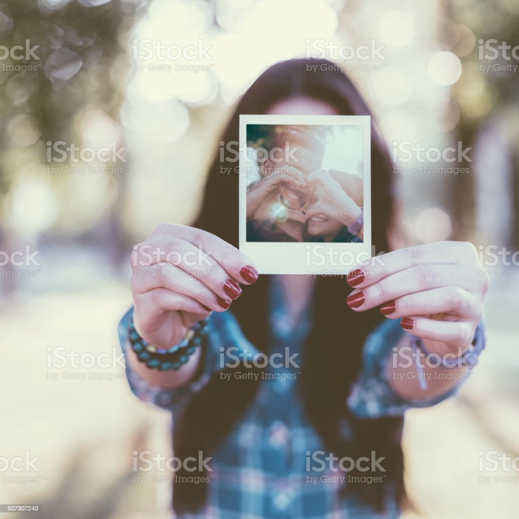 Girl showing instant photo stock photo