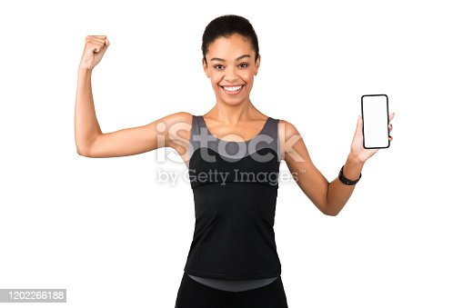 1159261513 istock photo Girl Showing Phone Blank Screen And Biceps Posing, White Background 1202266188