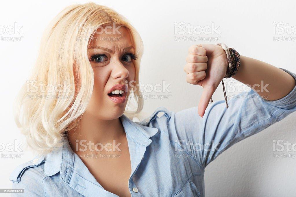girl showing thumb down stock photo