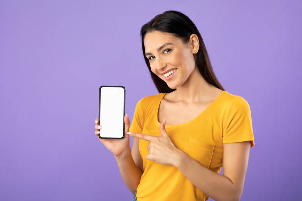 Girl showing white blank cell phone screen stock photo