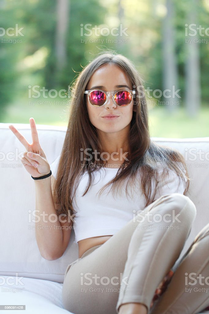 Girl shows victory sign royalty-free stock photo