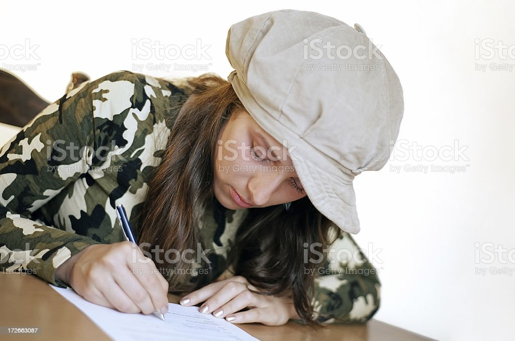 Girl signing agreement royalty-free stock photo