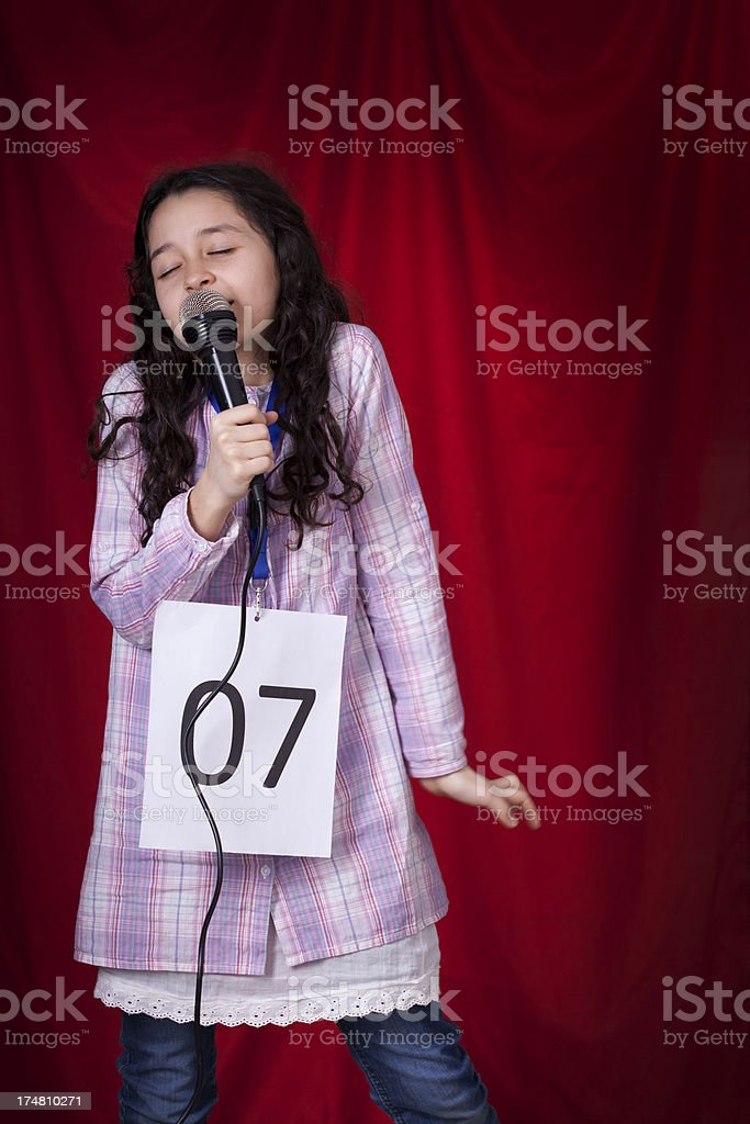 girl singing at audition stock photo
