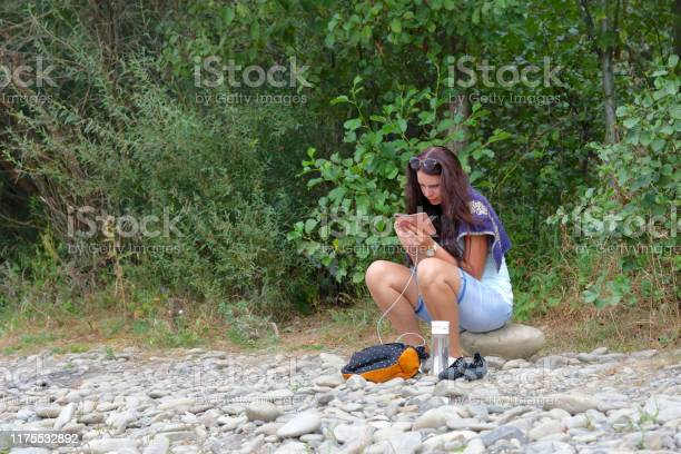 Girl sits on the shore of a mountain river and looks into a nearby picture id1175532892?b=1&k=6&m=1175532892&s=612x612&h=8pt5r3 kyag5ubnp2rwrkid8jyprg hdikqpeiistay=