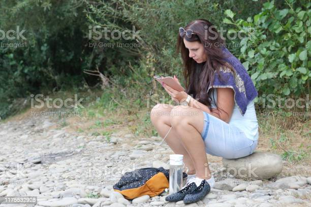 Girl sits on the shore of a mountain river and looks into a nearby picture id1175532928?b=1&k=6&m=1175532928&s=612x612&h= nqi9mkijkfd6jprrozcanqwac rxdhhlnivcz1wgg4=