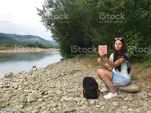 Girl sits on the shore of a mountain river and looks into a nearby picture id1175533083?b=1&k=6&m=1175533083&s=612x612&h=pvc4avjajxwkldtjxzmhfiae144pbtai2kfvv1jh4oq=