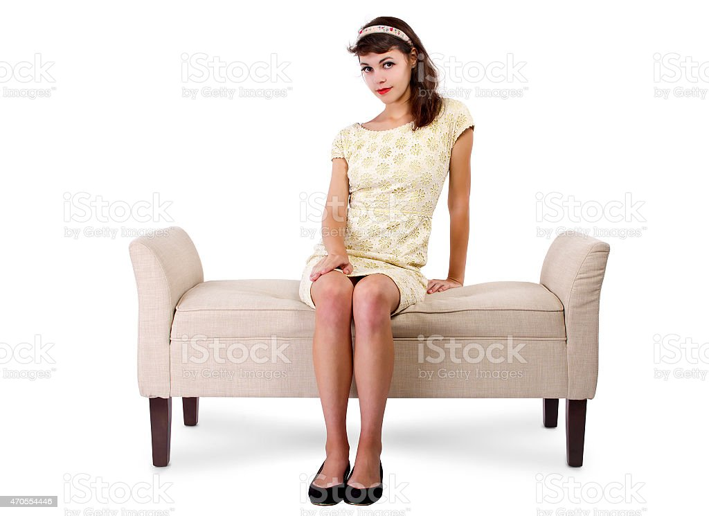 Girl Sitting and Waiting on a Chaise Lounge Sofa stock photo