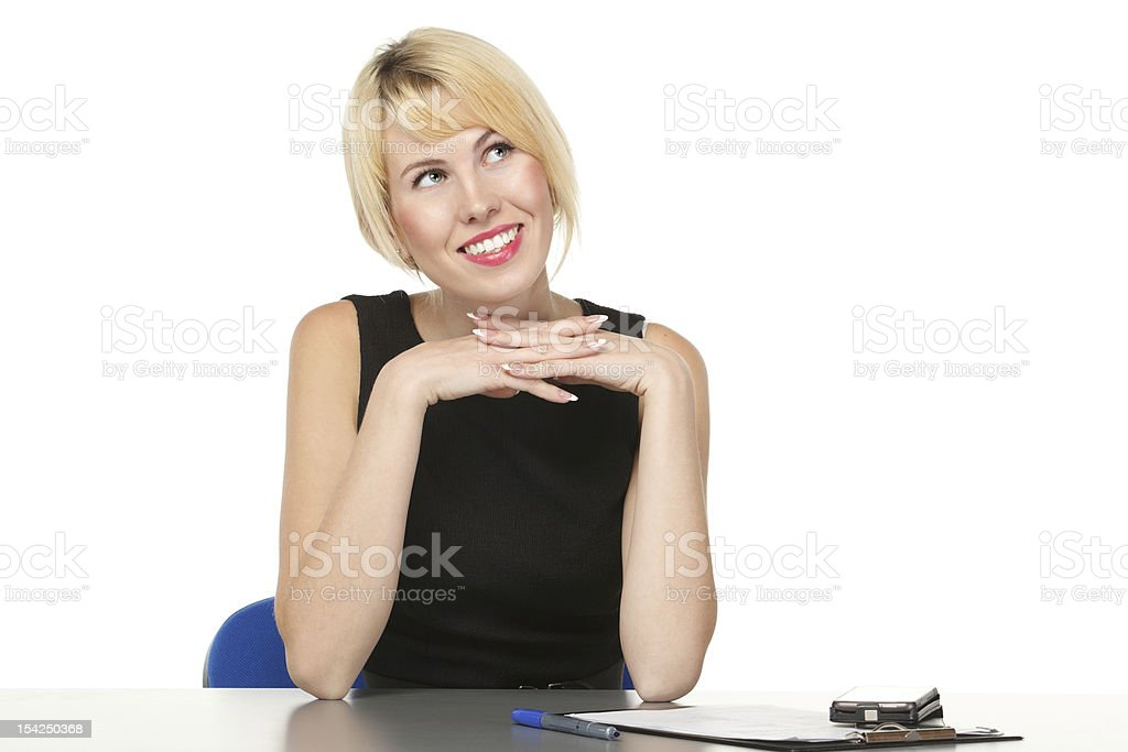 Girl sitting at the table stock photo