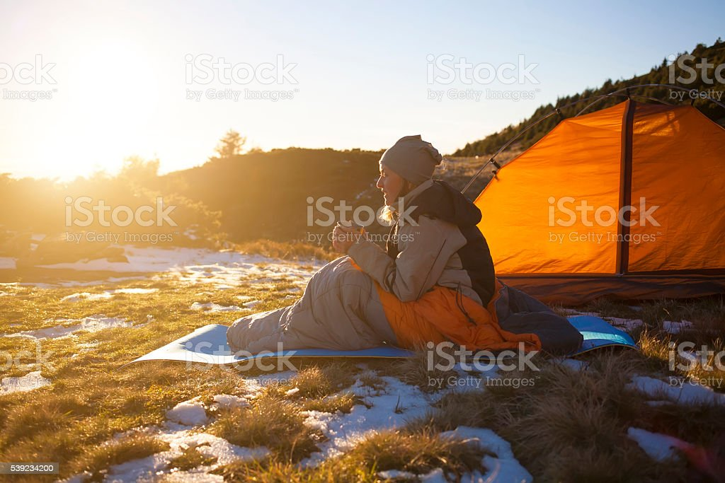 Girl sitting in a sleeping bag. royalty-free stock photo