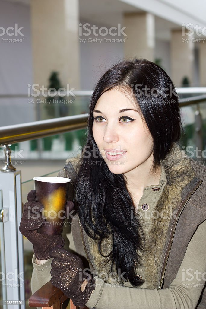 Girl sitting in cafe in the mall stock photo
