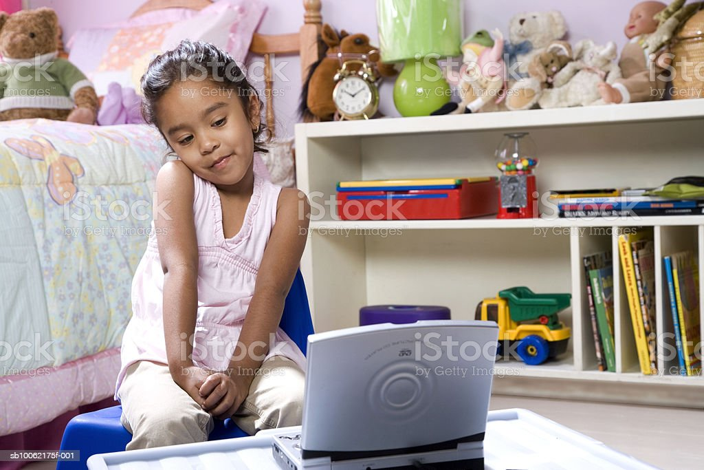Girl (4-5) sitting in front of laptop royalty-free 스톡 사진