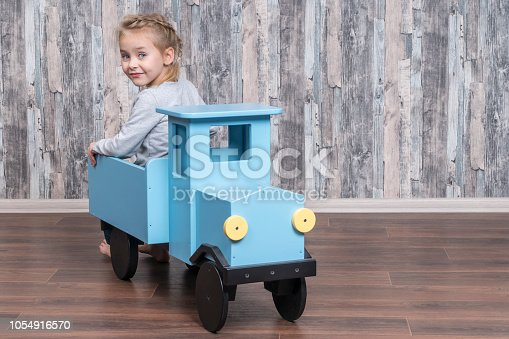 1035136022 istock photo girl sitting in the trunk of truck 1054916570