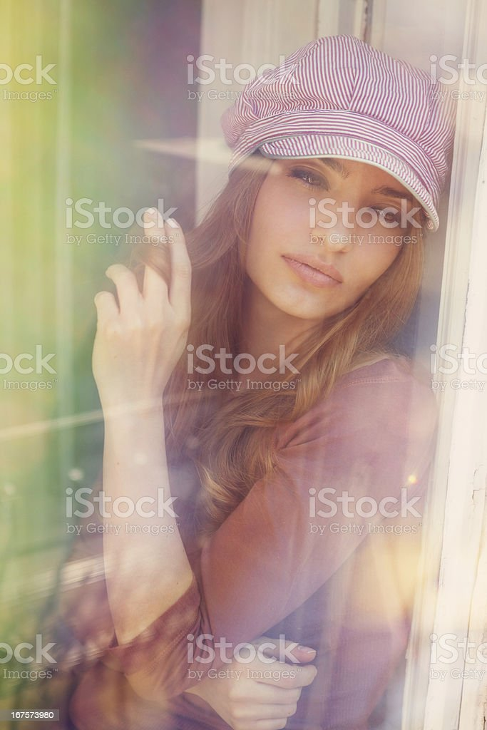 girl sitting in the window royalty-free stock photo