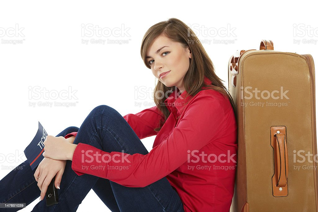 Girl sitting near a suitcase royalty-free stock photo