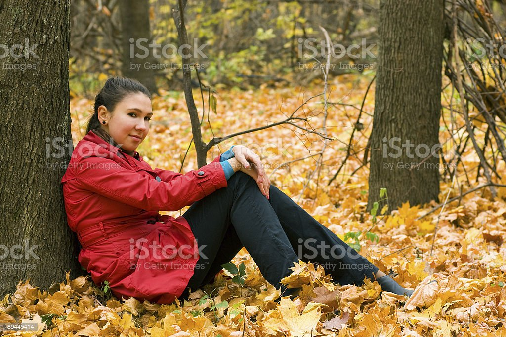 Girl Sitting Near Tree royalty-free stock photo