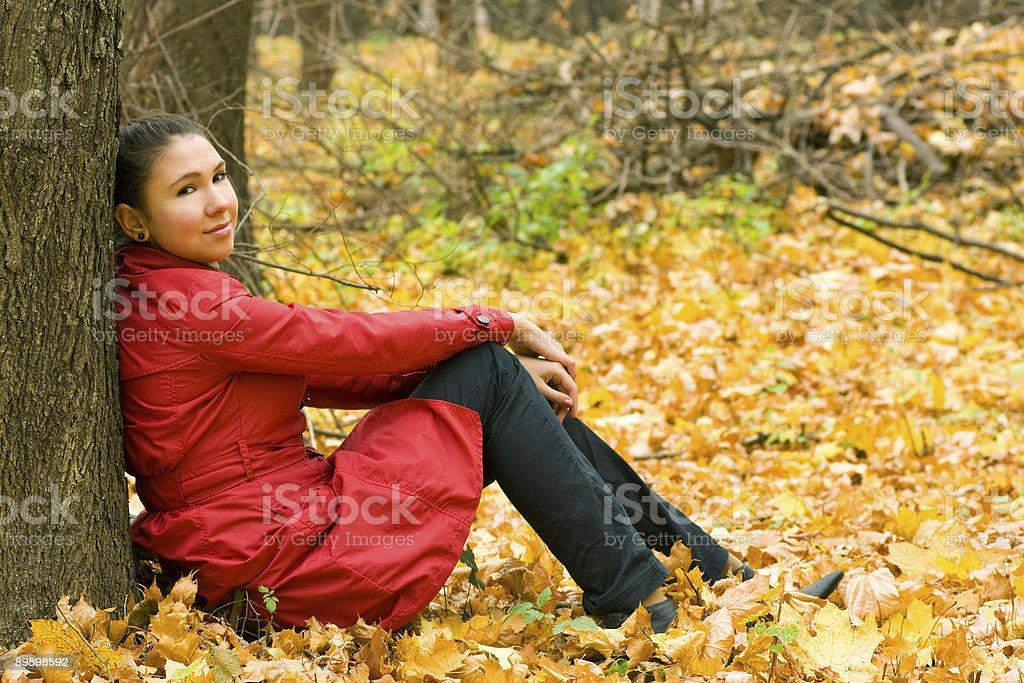 Girl Sitting Near Tree royalty-free stock photo