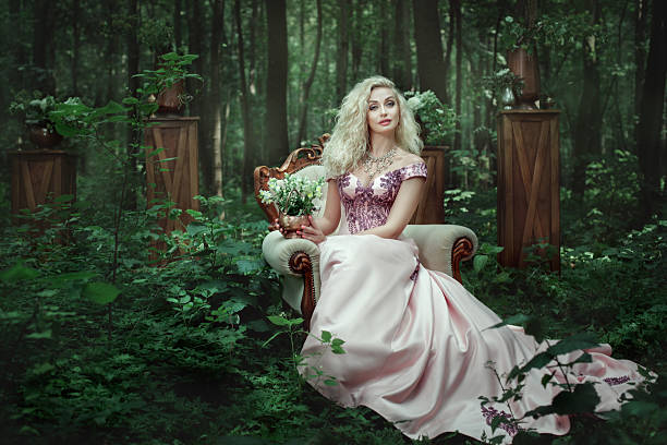 girl sitting on a chair in the forest. - beautiful curvy girls stock photos and pictures