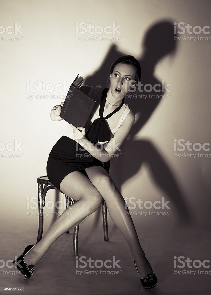 Girl sitting on a chair royalty-free stock photo