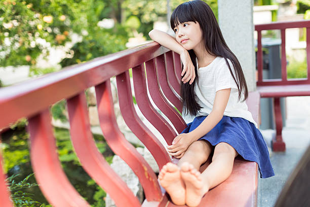 girl sitting on a chair stock photo