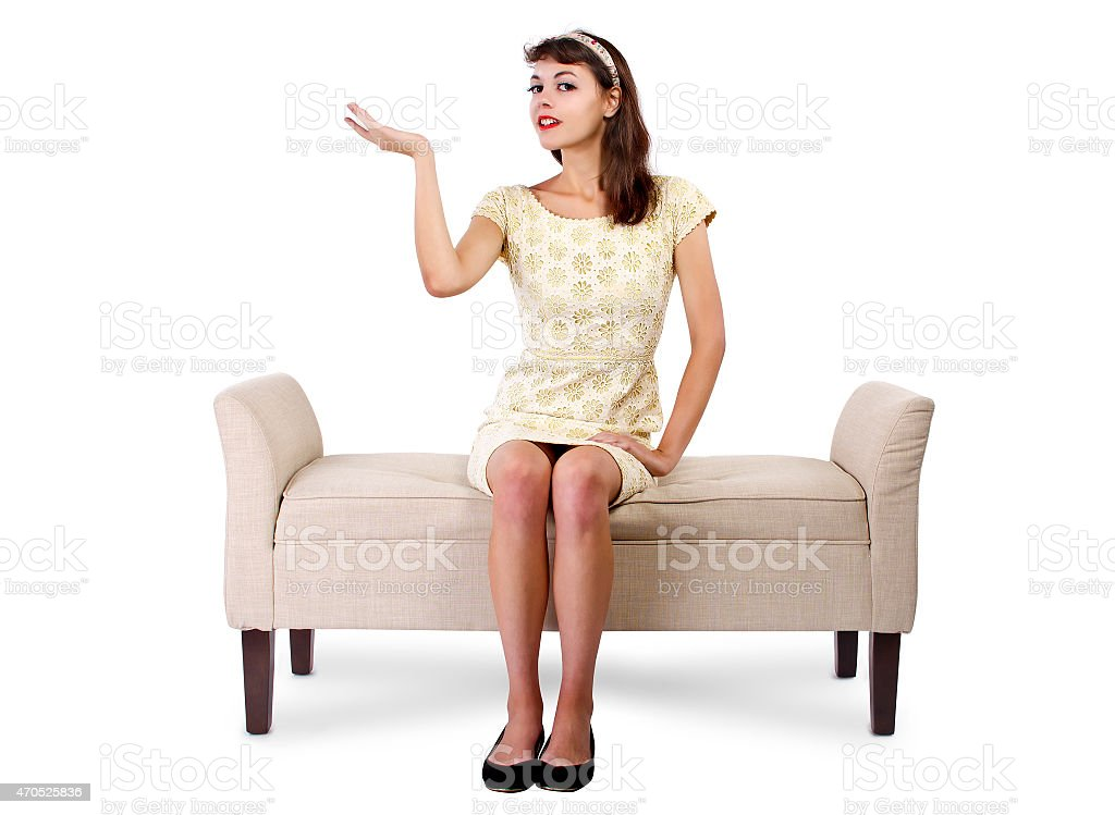 Girl Sitting on a Chaise Lounge Advertising or Presenting Something stock photo