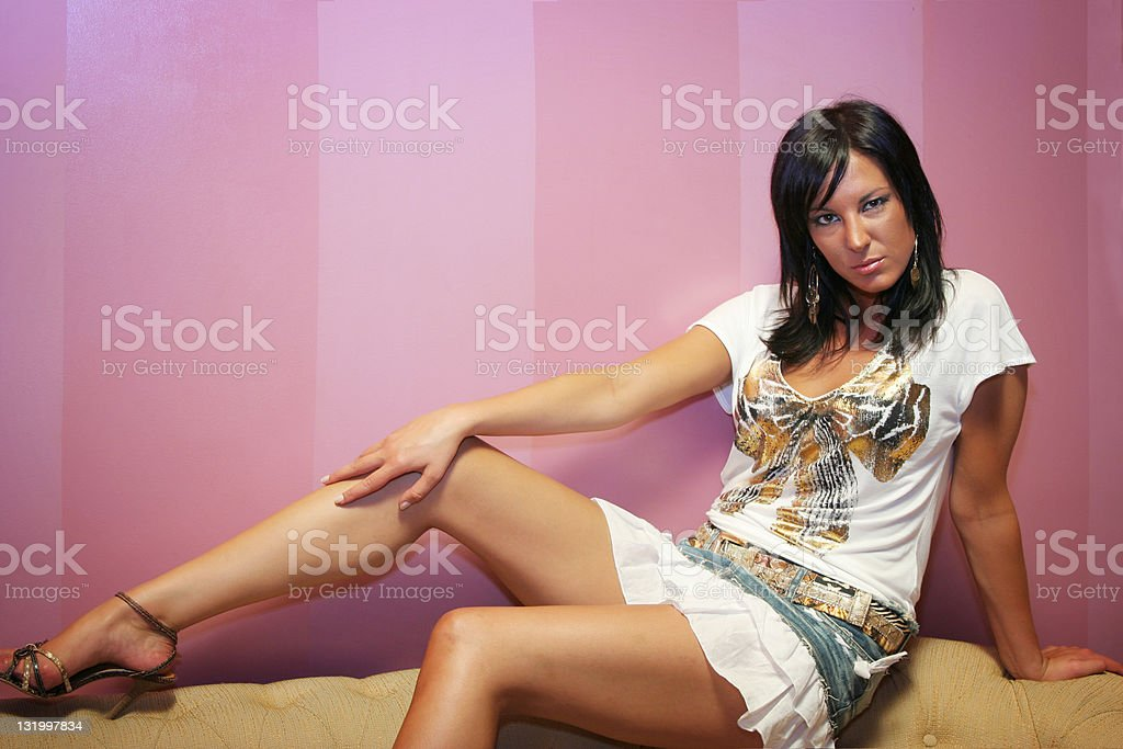 Girl sitting on a couch royalty-free stock photo