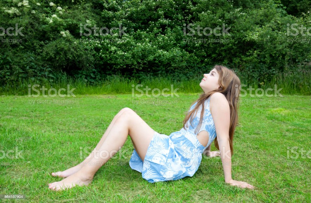 girl sitting on grass royalty-free stock photo