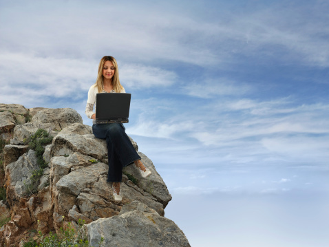 Girl Sitting On Hill Stock Photo - Download Image Now