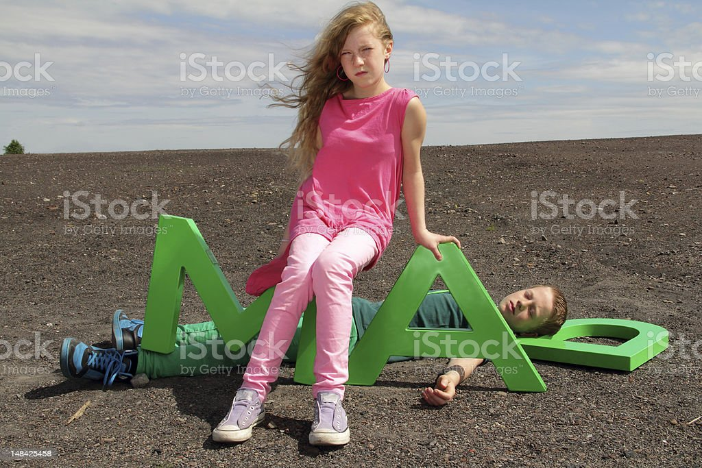 girl sitting on letters stock photo