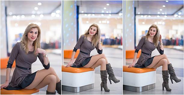 Mädchen sitzt auf Orange Tisch in modernen Einkaufen Zentrum – Foto