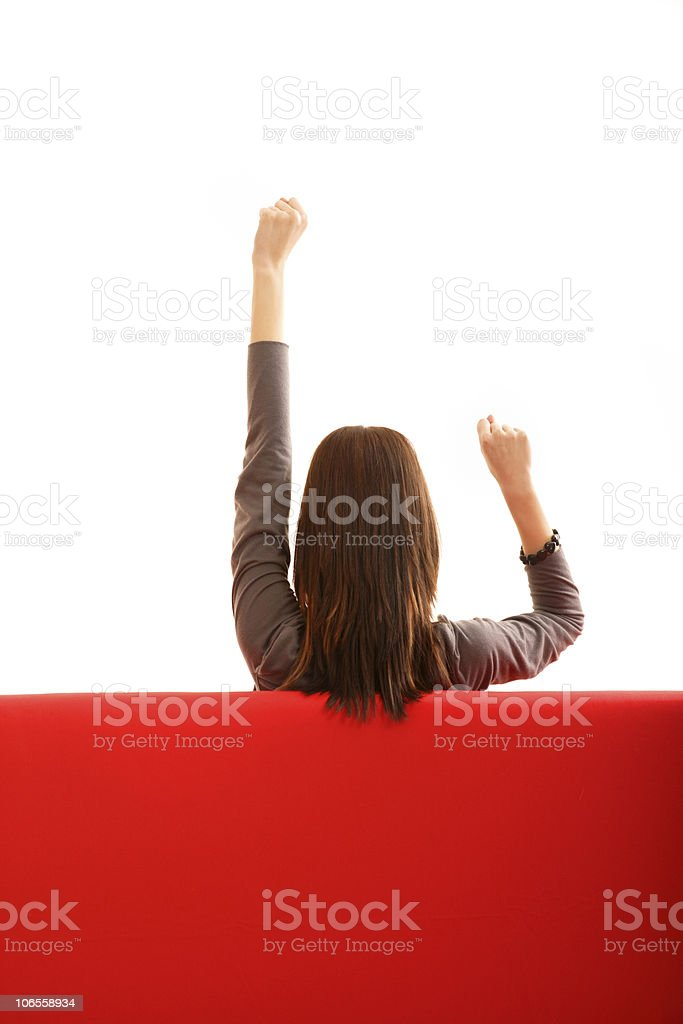 Girl sitting on red sofa royalty-free stock photo