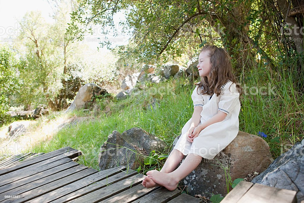 Girl sitting on rock 免版稅 stock photo
