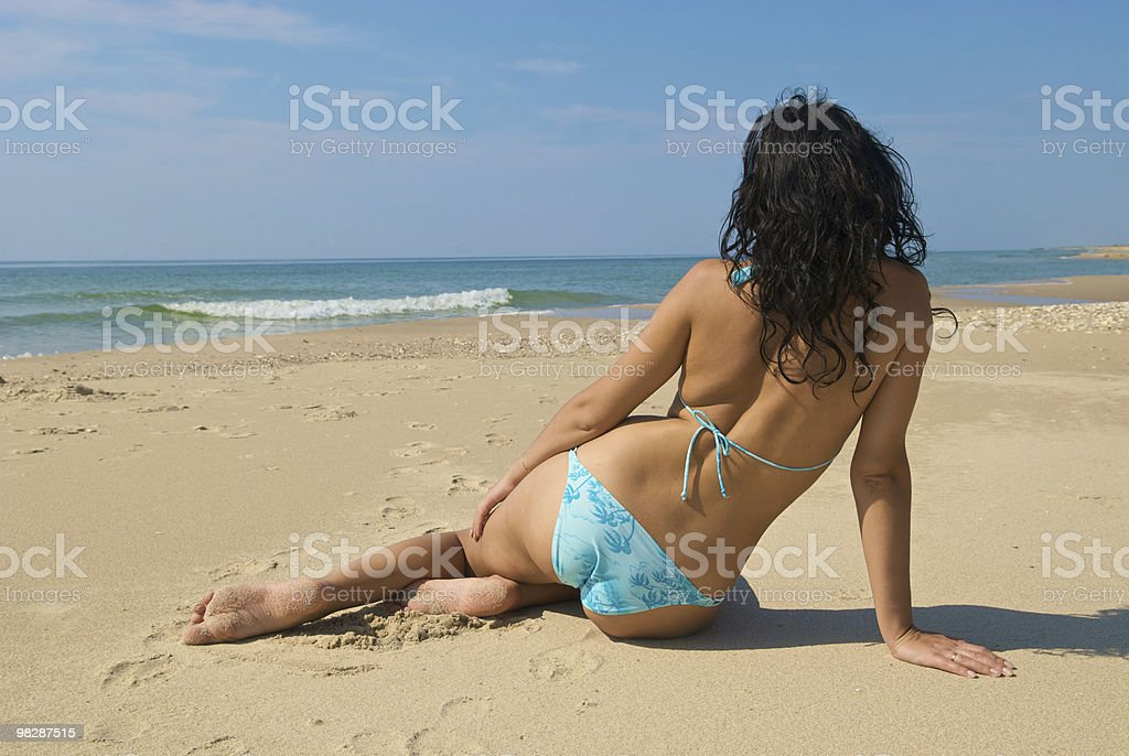girl sitting on the beach royalty-free stock photo