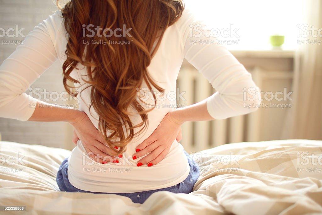 girl sitting on the bed in the bedroom stok fotoğrafı