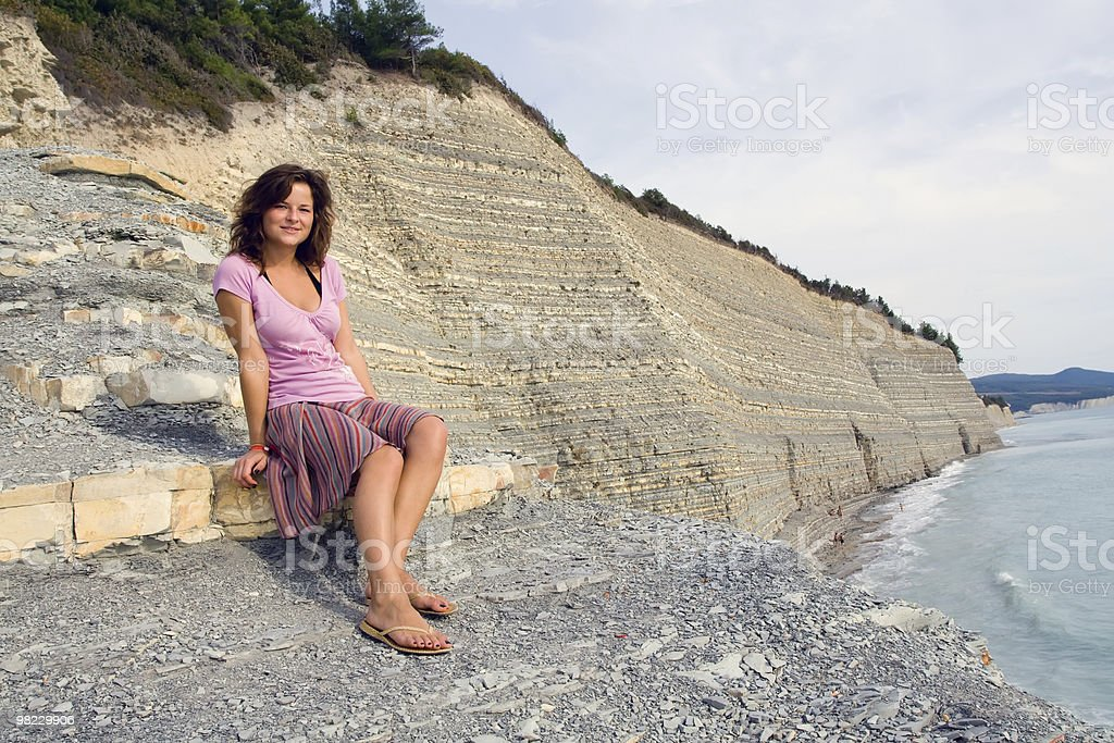 Girl sitting on the rock royalty-free stock photo