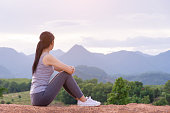 istock girl sitting on top of mountain 1168602283