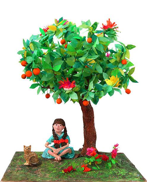 Girl sitting under tree stock photo