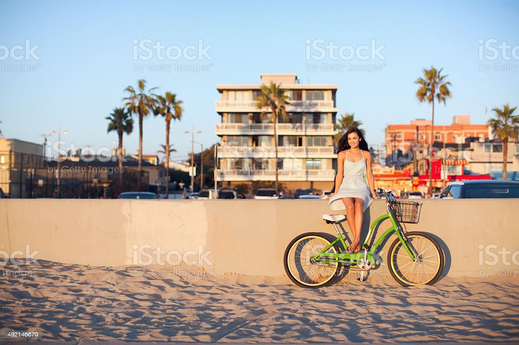 Girl Sitting With Bike at Beach stock photo