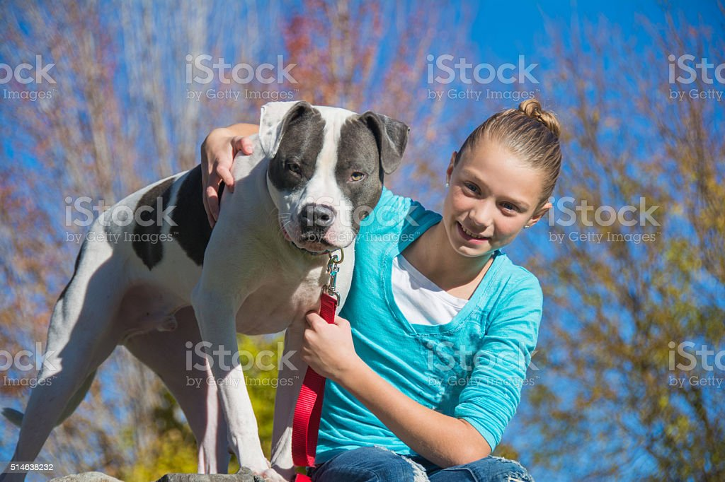 Girl Sitting with Her Dog stock photo