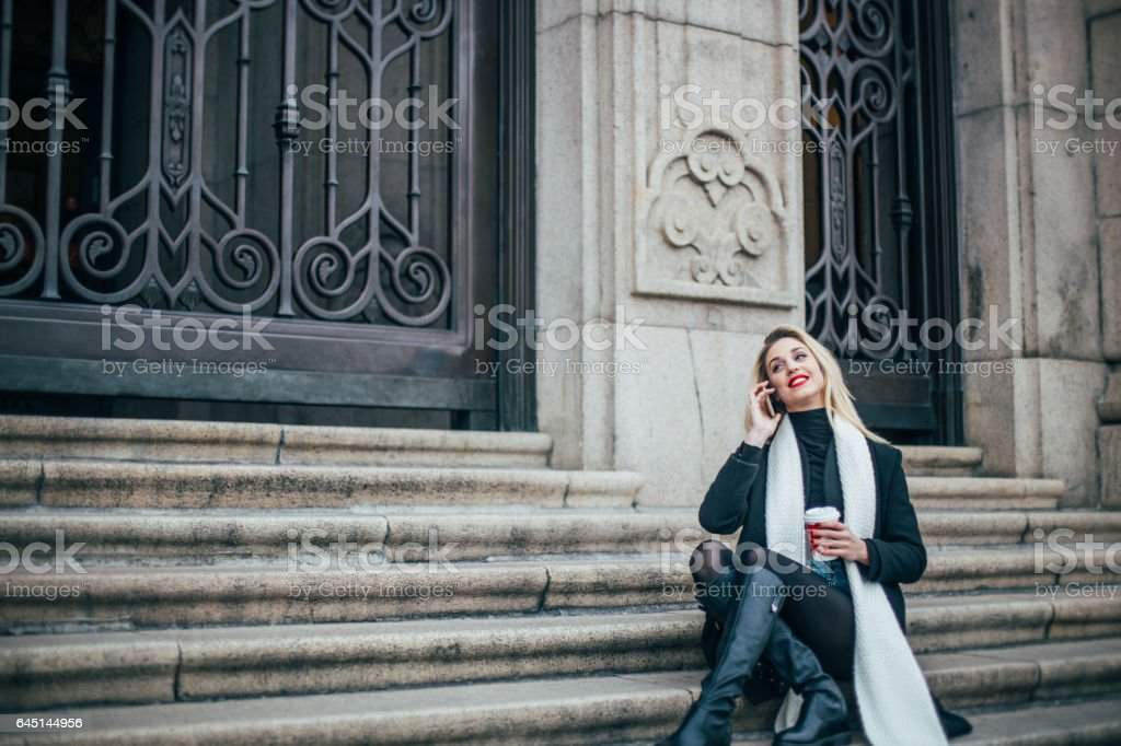 Girl sittting on steps stock photo