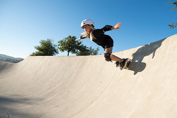 girl skateboarding - skateboard stock pictures, royalty-free photos & images