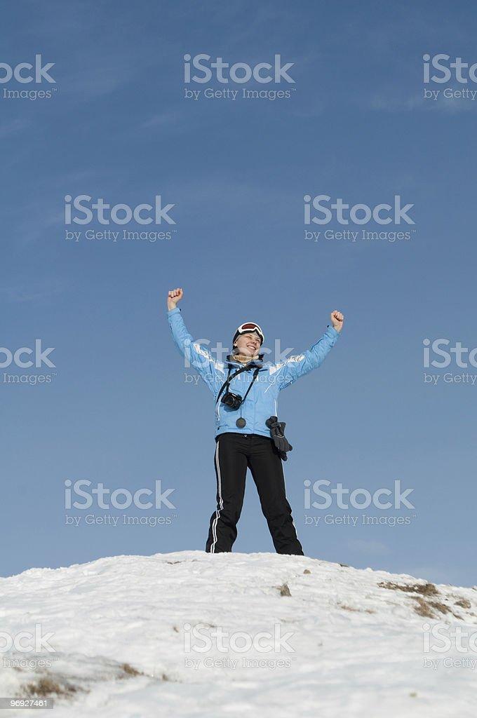 Girl skier on the mountain peak royalty-free stock photo