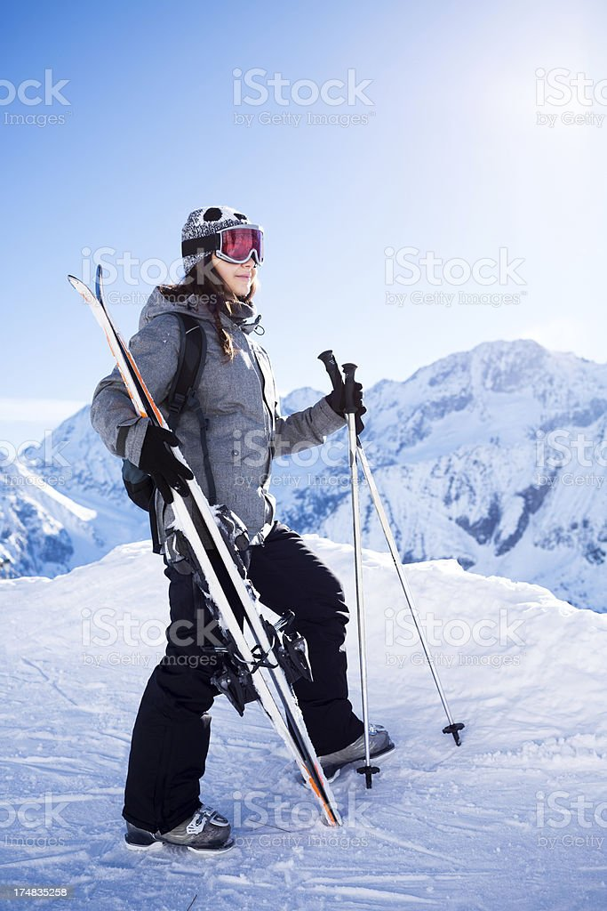 Girl skier on the top of a snowy  mountain slope royalty-free stock photo