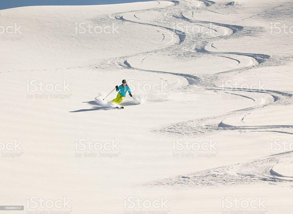Girl skiing powder snow, New Zealand. stock photo