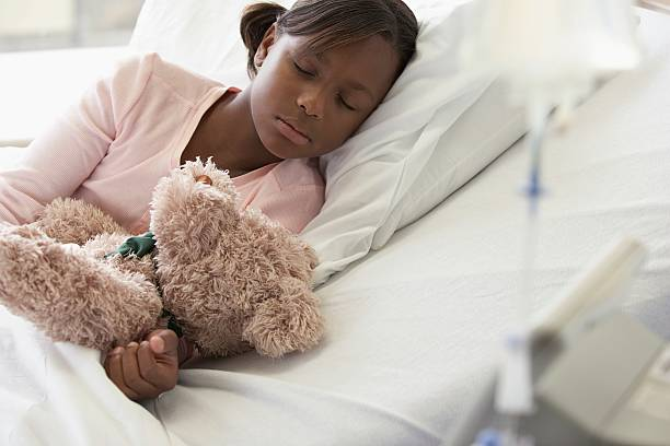 Girl sleeping in a hospital stock photo