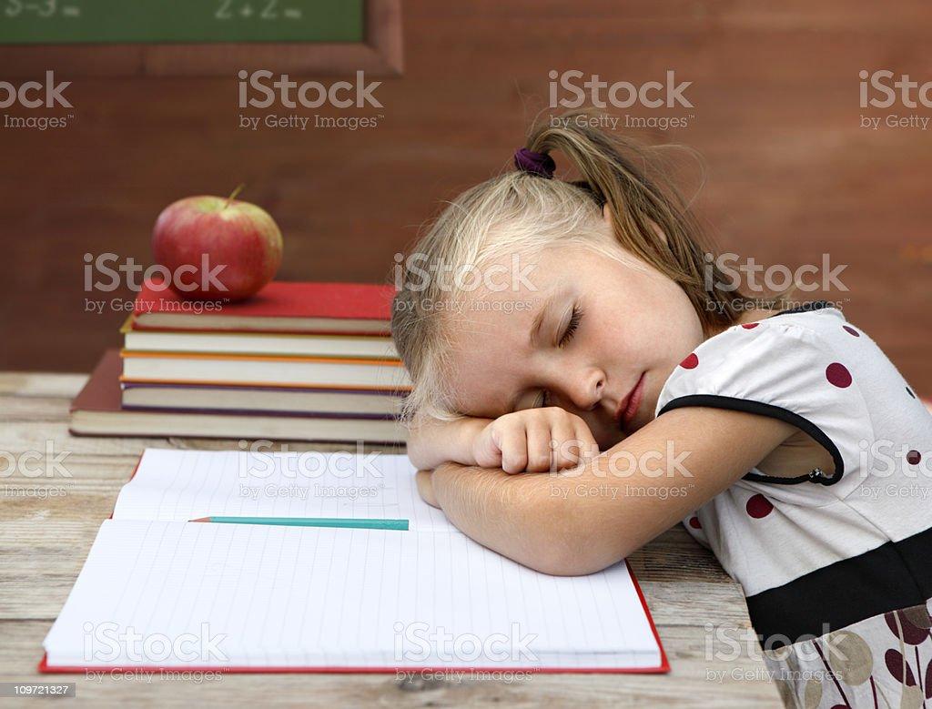 Girl sleeping in classroom royalty-free stock photo