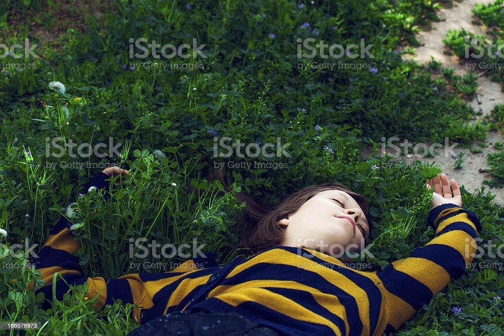 Girl Sleeping In Grass royalty-free stock photo