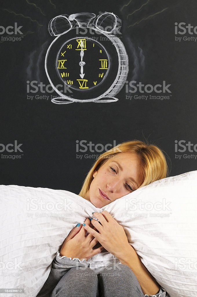 Girl Sleeping under Alarm Clock royalty-free stock photo