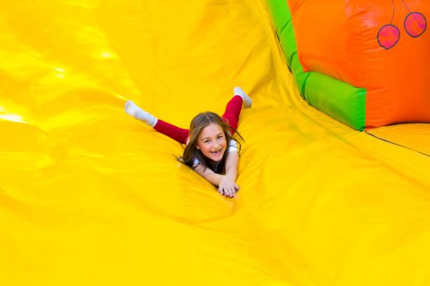 Girl Slide Down stock photo