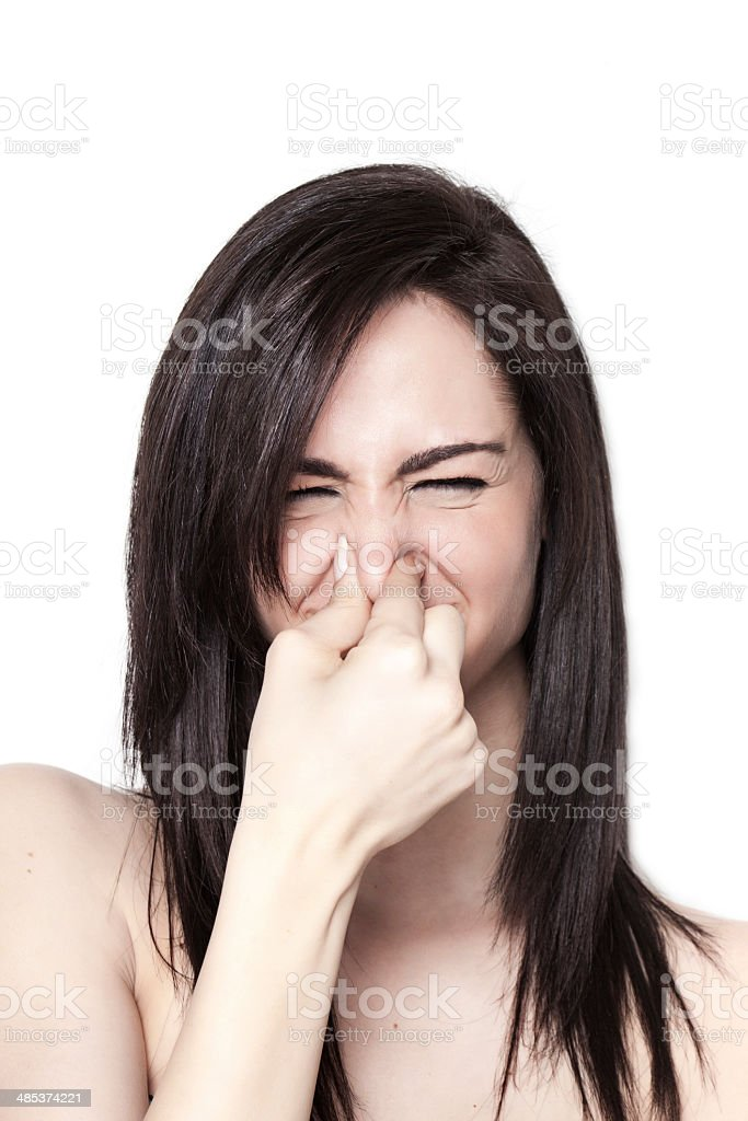 Girl smelling a bad odor stock photo