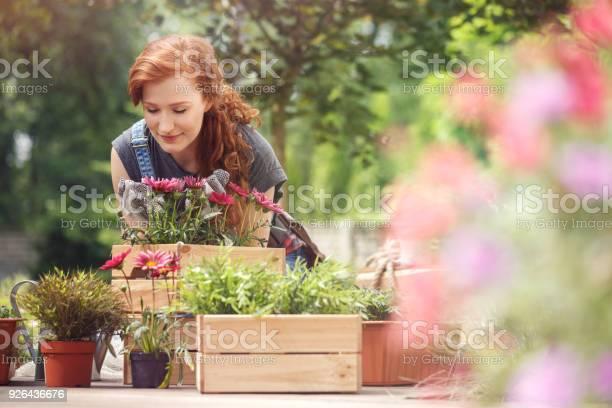 Girl smelling red flowers picture id926436676?b=1&k=6&m=926436676&s=612x612&h=p7deq4tygthch3rg7029l7wagm7y aorws7 tsy6u u=